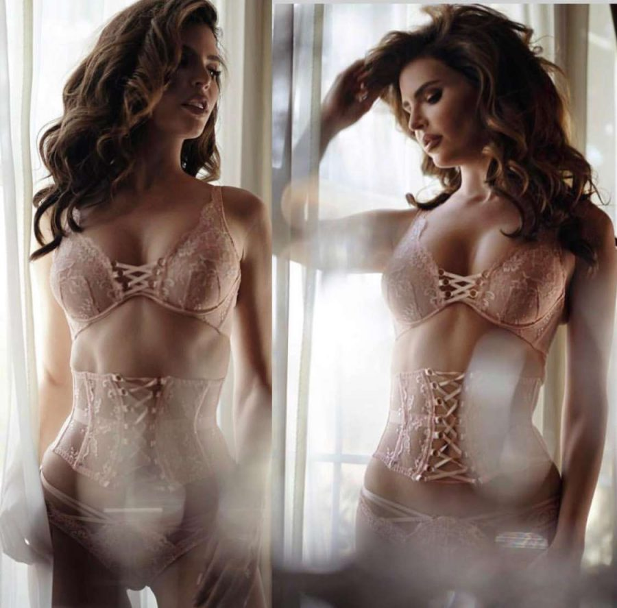 Brunette bridal boudoir model posing in pink lace