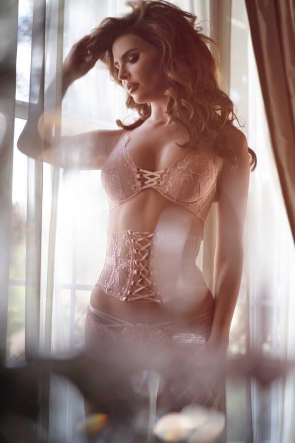Bridal boudoir model in pink lace