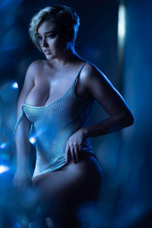 Plus sized model Heather Depriest with shoulder strap undone