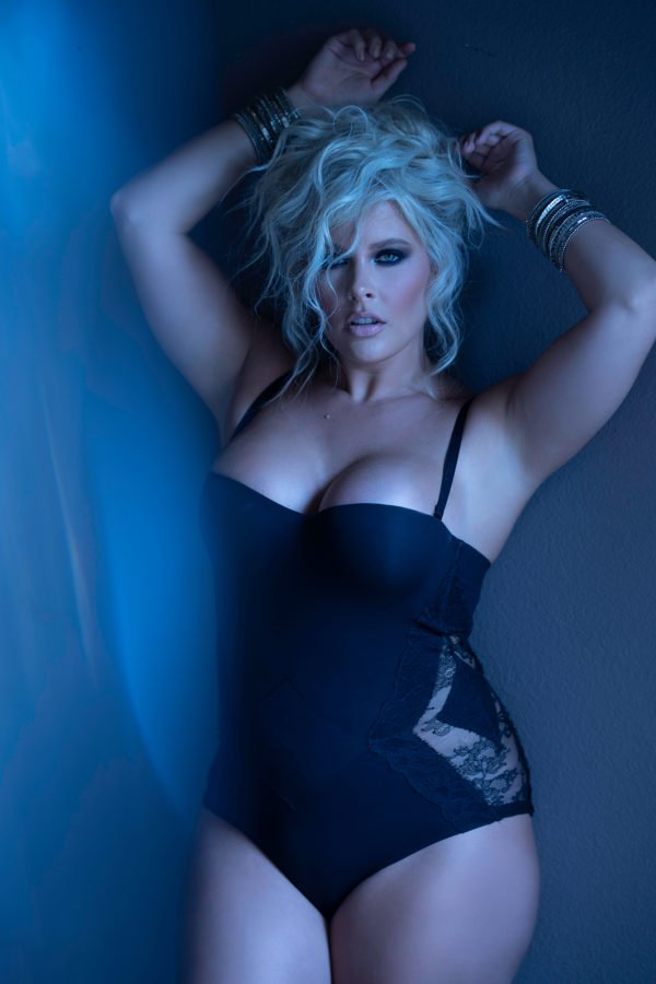 curvy woman wearing black la parla corset