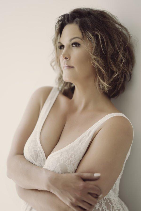 curvy woman wearing a white lacy slip