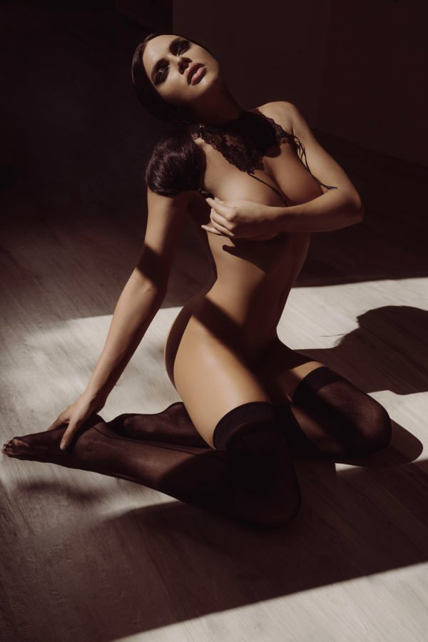 Kelsie Smeby Guess Jeans model wearing black pantyhose on the floor