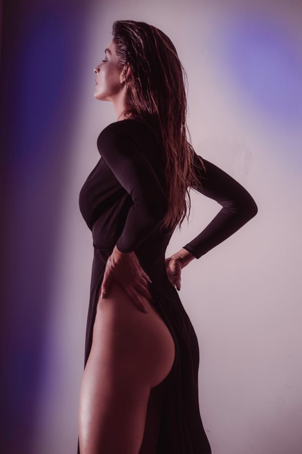 model in black long dress with a very high cut slit