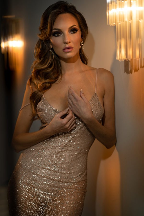 glamour photo of a model in sparkly dress