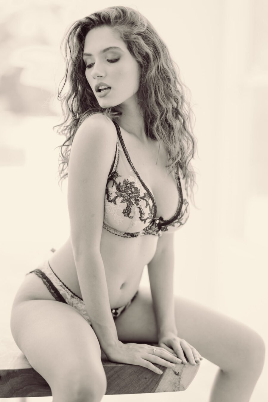 Bianca Rodrigues posing in lingerie in a black and white photoshoot