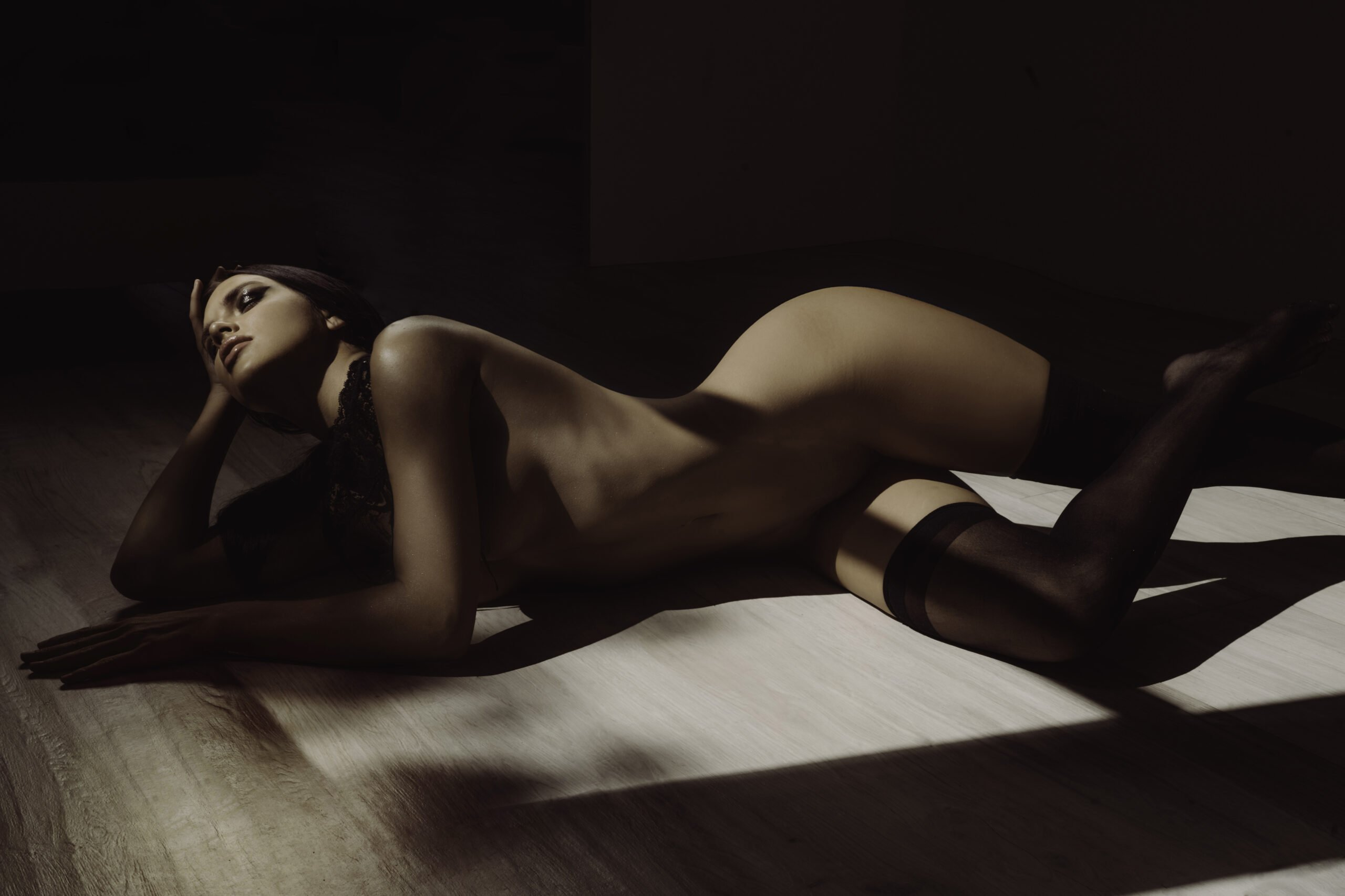 implied nude of a dark haired model in Orange County CA