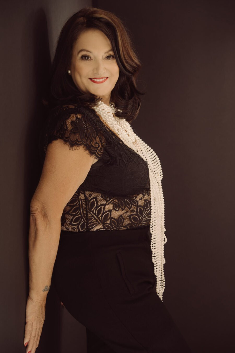 glamour photoshoot of a retired national guard in black lace top and pants