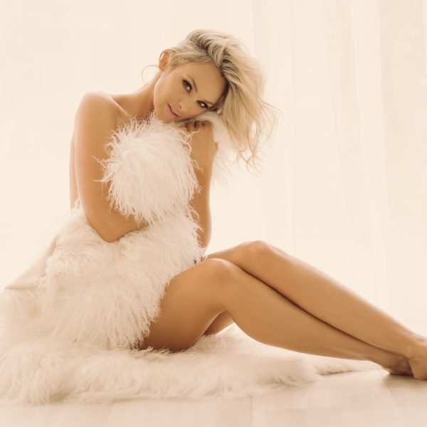 Implied Nude in a Fur White Throw