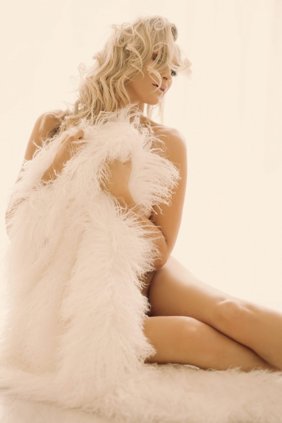 Implied Nude on a White Fur Throw by Caroline Malouf Photography
